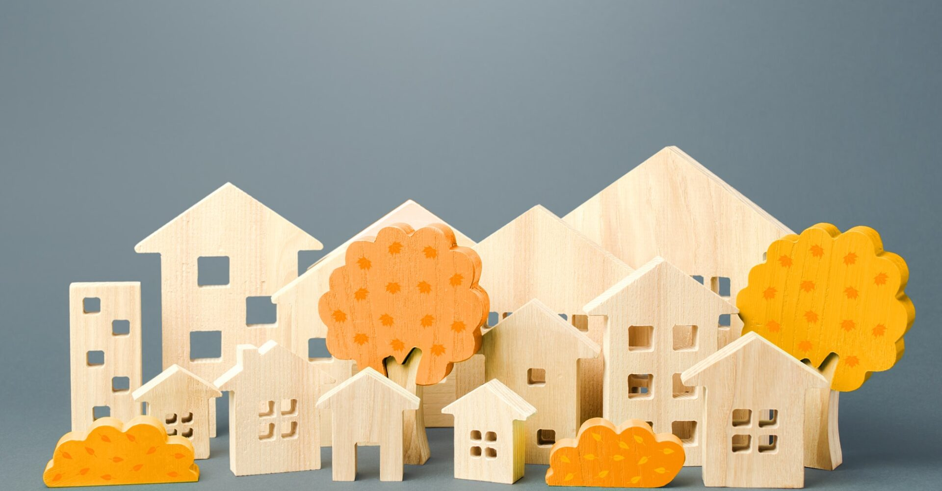 City of figures houses and autumn yellow trees. Real estate concept. Urbanism and infrastructure. Re